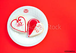two heart shaped decorated cookies and