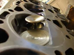 Has anyone actually tried 305 Heads on a 350 block - Third ...