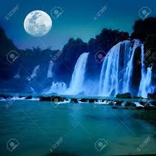 beautiful waterfall under moonlight at night time stock photo 6918622