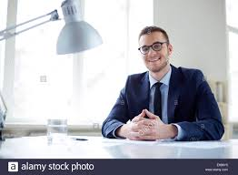Employee Office Portrait Of Smiling Employee Looking At Camera In Office Stock Photo