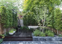 in this small brooklyn backyard garden designer brook klausing used imported marble pavers and wooden