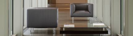 Image showing two gray q_bic armchairs in a hallway lounge area.