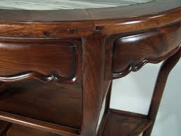 lovely chinese antique half round console table with angled shelves made of huanghuali the rarest of chinese rosewoods the surface is inset with a thick