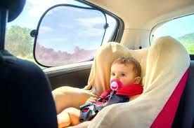 top baby car seat baby sitting in car seat with sun protection from car sun shade top baby car seat