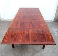 scandinavian modern mid century danish modern eight foot rosewood dining table by kai winding