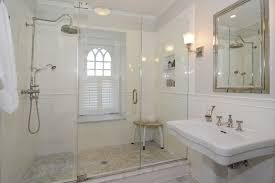 bathroom chair molding. traditional 3/4 bathroom with handheld shower head, wall sconce, frameless showerdoor, chair molding
