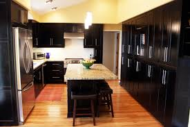 chic black color wooden shuler cabinets and combine with silver color stainless steel handles also white black color furniture office counter design