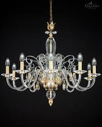 crystal chandelier made with gold leaf metal finish decorated with delicate ornaments swarovski elements