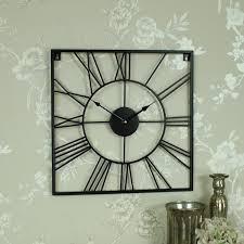 large black iron square skeleton wall clock