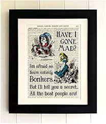 framed alice in wonderland art print on old antique book page alice with the mad