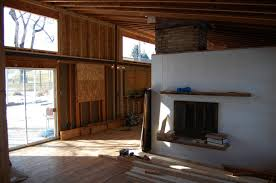 here is the new living room and the kitchen around the corner in the back old ceiling height was at the bottom of that steel beam