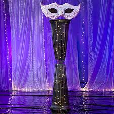 Masquerade Ball Decorations Centerpieces The Masquerade Ball Mask Column features a fabric stretch column 88
