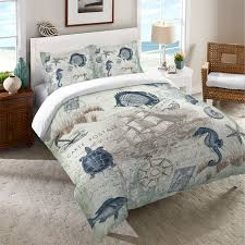 a vintage coastal themed duvet featuring c and and soft green sea creatures and
