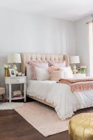 A Blush Upholstered Bed, Pink Textiles, Various Rugs Add Glam To This  Bedroom