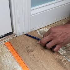 marking the height of the tile and substrate on a door jamb
