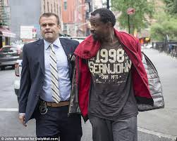 new york homeless man who shoved a bag of feces down a w s hill was apprehended at a homeless shelter in brooklyn after a tip off from the