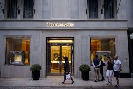 pedestrians walk past the tiffany co on rodeo drive in beverly hills