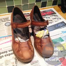 cover the surface you are using with newspsper and stuff the shoes with paper too to support them while you apply the dye