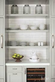 stacked gray floating kitchen shelves