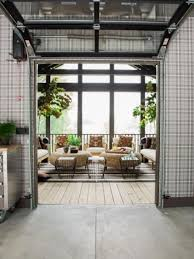 a garage door leading from the kitchen to the screened porch