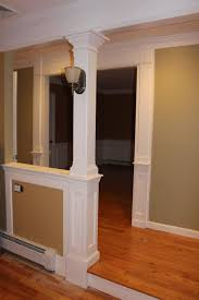 Half wall with column. For load bearing and to define foyer on enclosed  front porch
