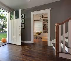 Gray walls, white trim, dark floors. by Manda