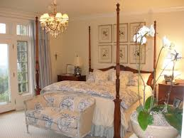 french design bedrooms. example of a classic carpeted bedroom design in portland with beige walls french bedrooms
