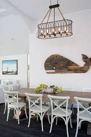 coastal dining room wiht nautical accents like this lovely wood whale art