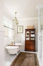 country master bathroom with glass lantern over claw foot tub