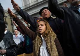 john pilger why the rise of fascism is again the issue a young girl gives the fascist salute during the 39th anniversary of the death of spanish
