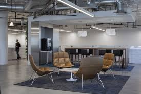 office design group. the color palette mixes both cool grays and warm browns while two living walls reclaimed wood wall coverings connect interior space with office design group