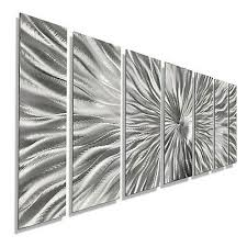 large brilliant silver abstract metal