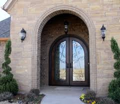 arched front doorArched double glass front door with wrought iron inlay  Strange