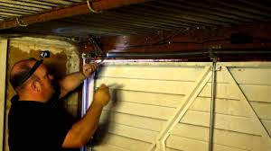 how to adjust the spring tension on a garage door in manchester you