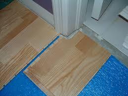 laying laminate flooring around door jamb round designs