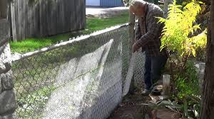wire fence covering. Converting My Chain Link Fence To A Stone Wall Wire Covering I
