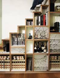 awesome open shelves under stairs many cubes shelves for dvd wine and books bright lighting ideas white wall paint wooden flooring