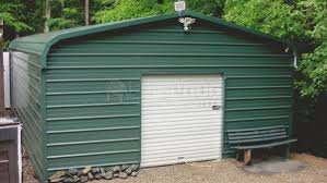regular roof style ever green garage with a 6x6 garage door on the front gable end