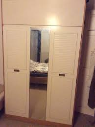 double wardrobe with long mirror and overhead storage area