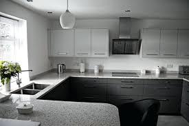 modern kitchen with white granite black and countertops