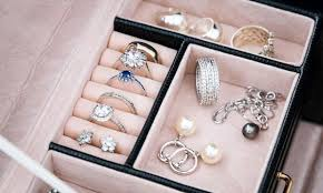 jewelry box with white gold and silver rings earrings and penda