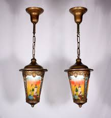 sold two matching antique brass pewter pendant lights with original painted ribbed glass lighthouse