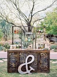 rustic outdoor wedding bar area / http://www.deerpearlflowers.com/