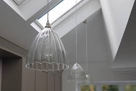 beautiful ceiling pendant lights installed on a sloping ceiling