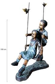 boy garden statues boy and girl playing on a swing with birds garden statue little boy boy garden statues