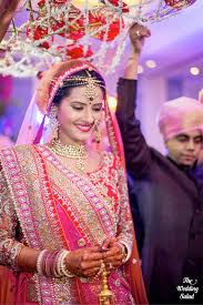 the colours that are usually avoided are black and white apart from her royal dress and other pieces of jewellery a nose ring or nath forms an integral