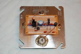 a remotely powered rf preamplifier for the 600 meter band the amplifier is built on a small perf board obtained at radio shack parts are placed as closely as possible to match the schematic diagram