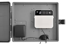 rainmachine mini 8 mounted inside of orbit 57095 sprinkler system weather resistant outdoor mounted control