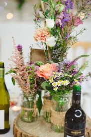 ... centerpiece rustic table centre pieces using roses and wild flowers,  recycled jam jars and hessian ...