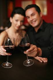 1677705 wine glass cheers couple proposing a toast